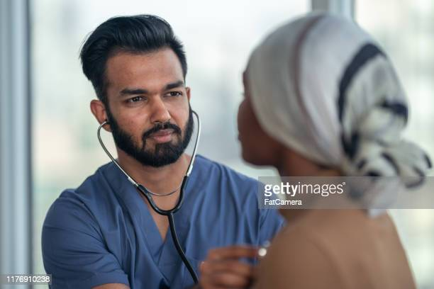 male doctor meeting with female patient fighting cancer - leukemia stock pictures, royalty-free photos & images