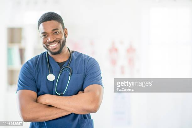 male doctor - civilian stock pictures, royalty-free photos & images