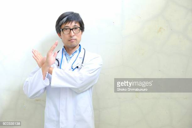 male doctor's portrait photo. - cross shape stock pictures, royalty-free photos & images