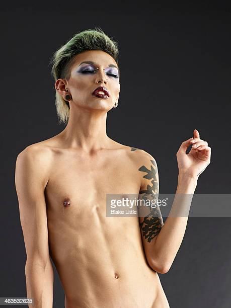 Male drag queen, shirtless in studio