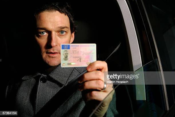 Male driver holding his ID card