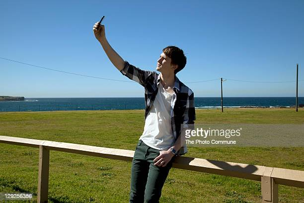 Male early 20s' trying to get mobile coverage