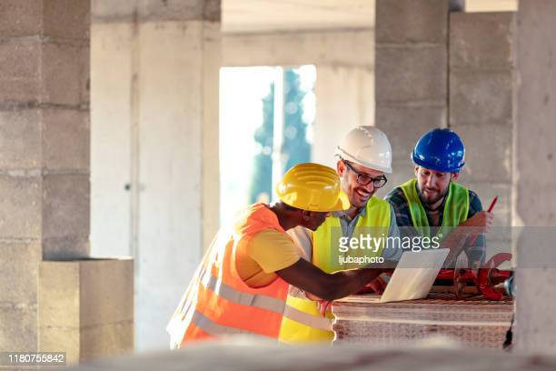 male engineer directing his team - real estate developer stock pictures, royalty-free photos & images