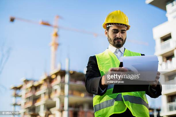 Male engineer looking at the papers