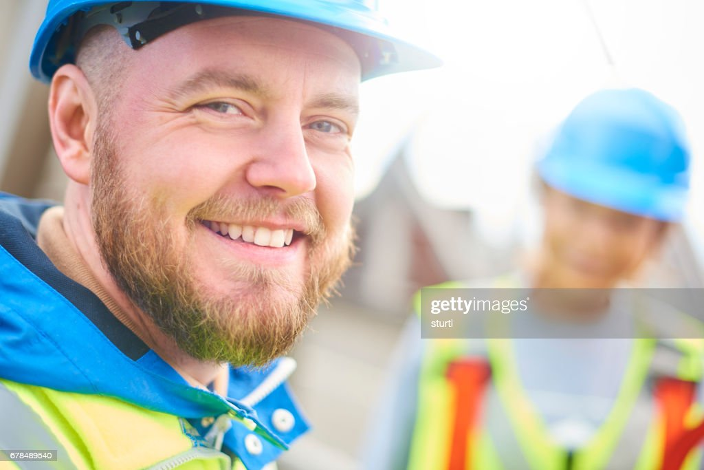 Male engineer smiles to camera : Stock Photo