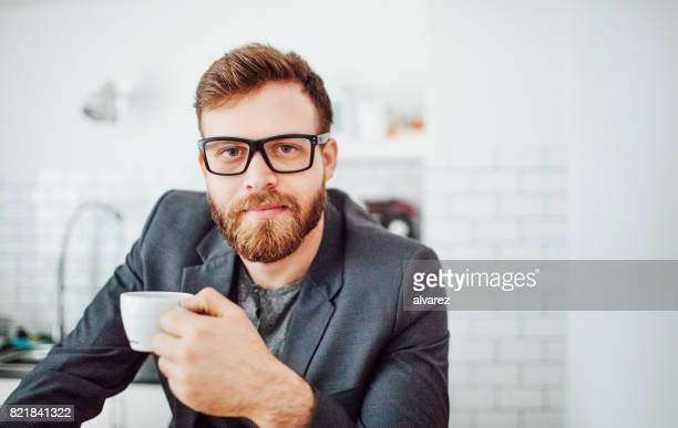 male entrepreneur taking coffee break - founder stock pictures, royalty-free photos & images