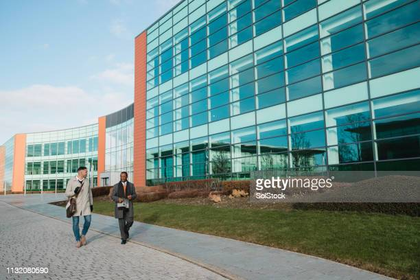 male entrepreneurs walking to the office - newcastle upon tyne stock pictures, royalty-free photos & images