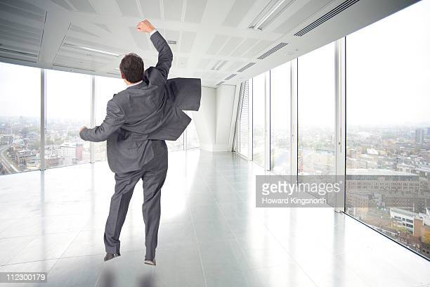 male esecutive jumping and punching air - hitting stock pictures, royalty-free photos & images
