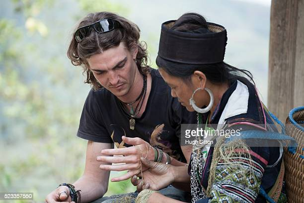 male european tourist travelling through sapa. vietnam - hugh sitton stock-fotos und bilder