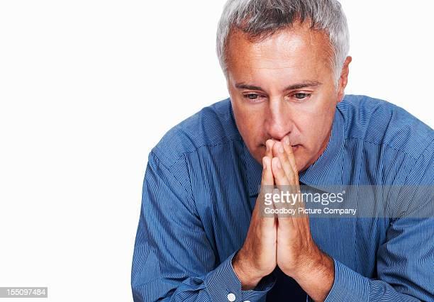 Male executive contemplating