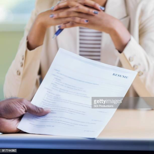 Male executive interviews female job applicant
