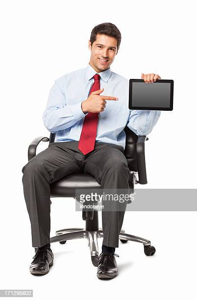 Male Executive Pointing At Digital Tablet - Isolated
