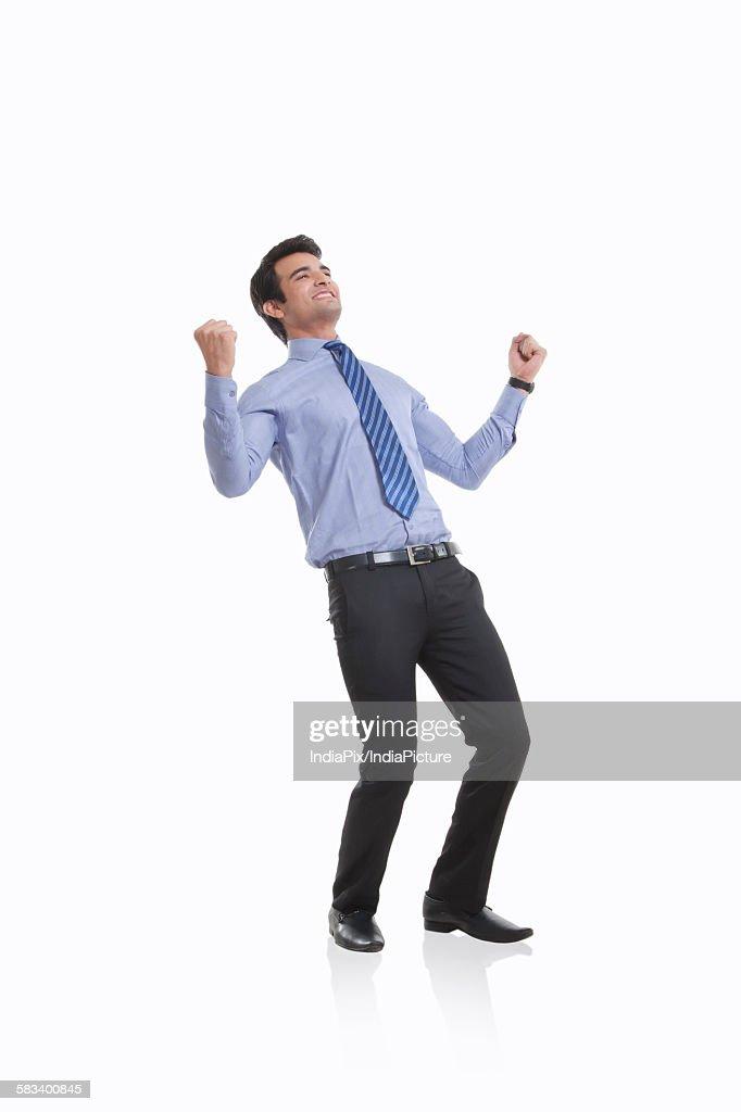 Male executive rejoicing : Stock Photo