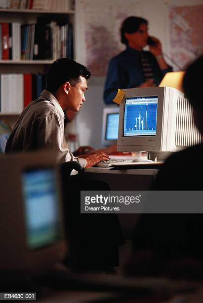 Male executive using computer in office