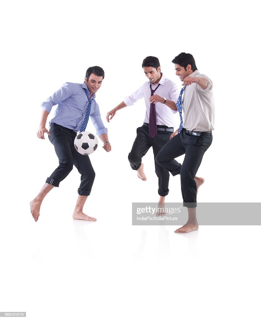 Male executives playing soccer : Stock Photo