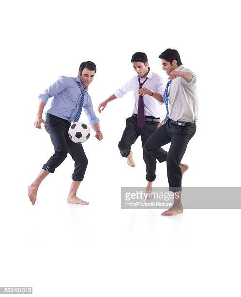 Male executives playing soccer