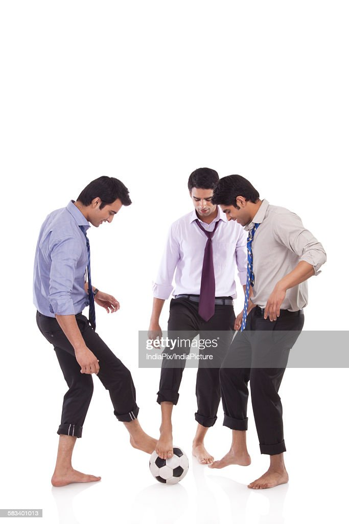 Male executives with a football : Stock Photo