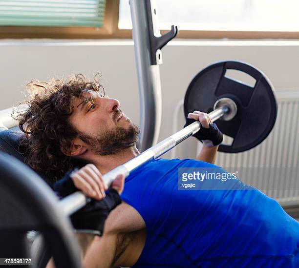Male exercising in a gym.