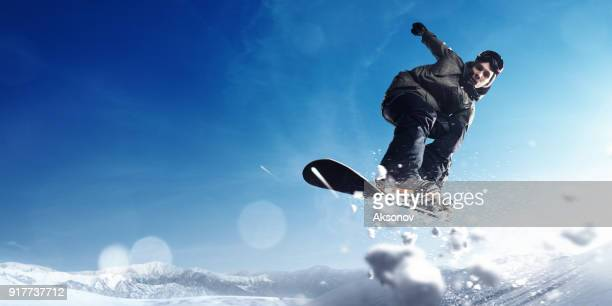 male extreme freestyle snowboarder jump - half pipe stock pictures, royalty-free photos & images