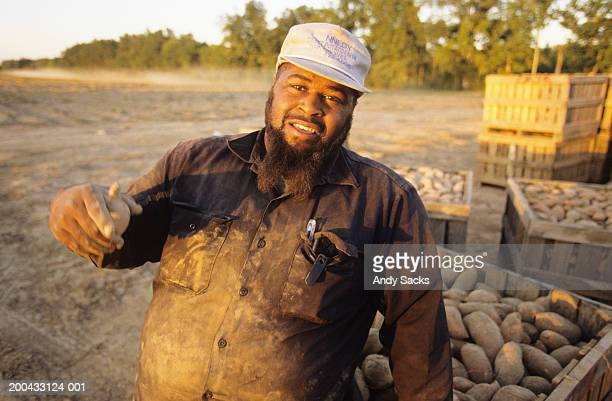 male farmer by sweet potato bins, close-up, portrait - louisiana stock pictures, royalty-free photos & images