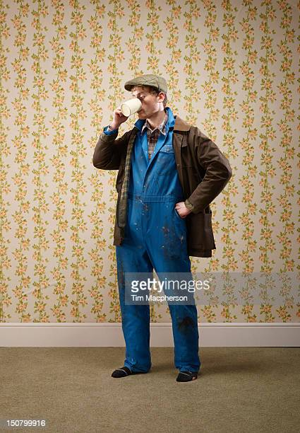 male farmer drinking from a cup - flat cap stock pictures, royalty-free photos & images