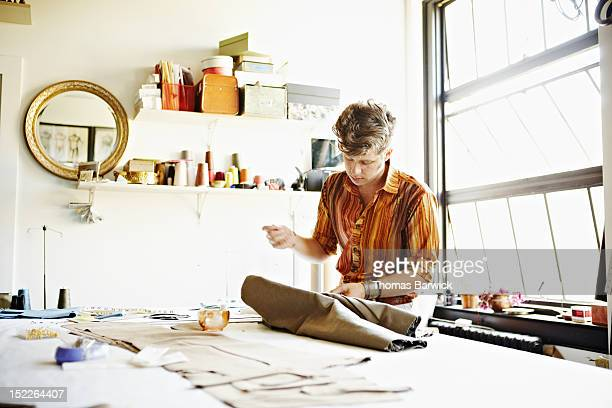 Male fashion designer at workbench in studio