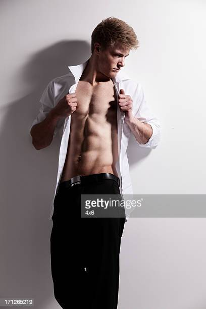 male fashion model posing - helemaal losgeknoopt stockfoto's en -beelden