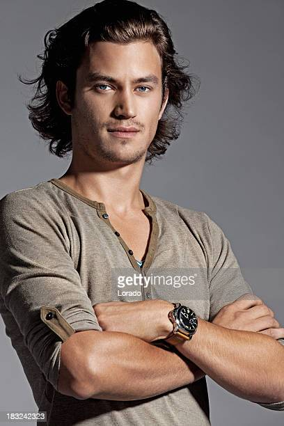 male fashion model posing - long hair stock pictures, royalty-free photos & images