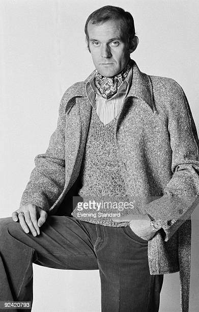A male fashion model wearing a short jacket and cravat September 1972