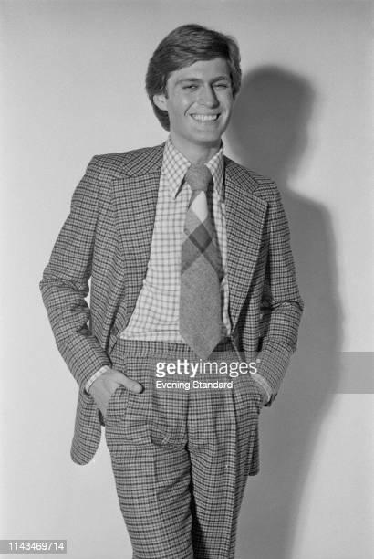 A male fashion model wearing checked suit checked shirt and tie UK 26th November 1975