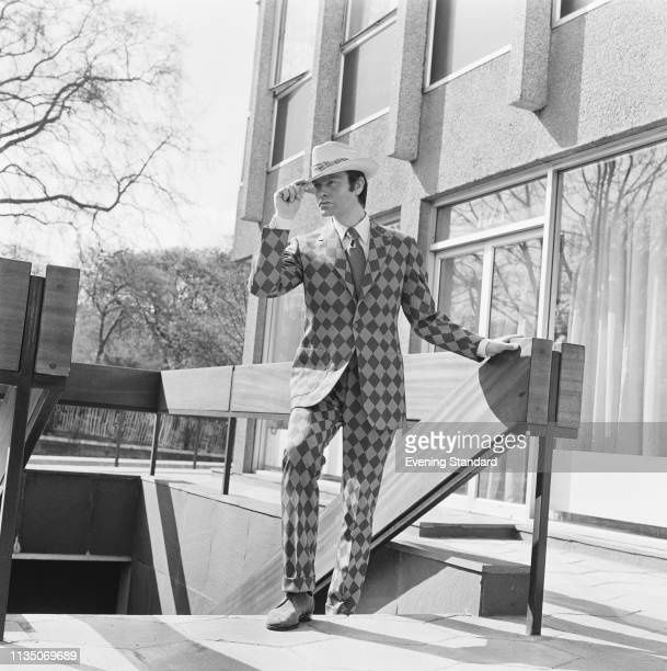 A male fashion model wearing diamond check pattern suit and straw hat UK 17th April 1969