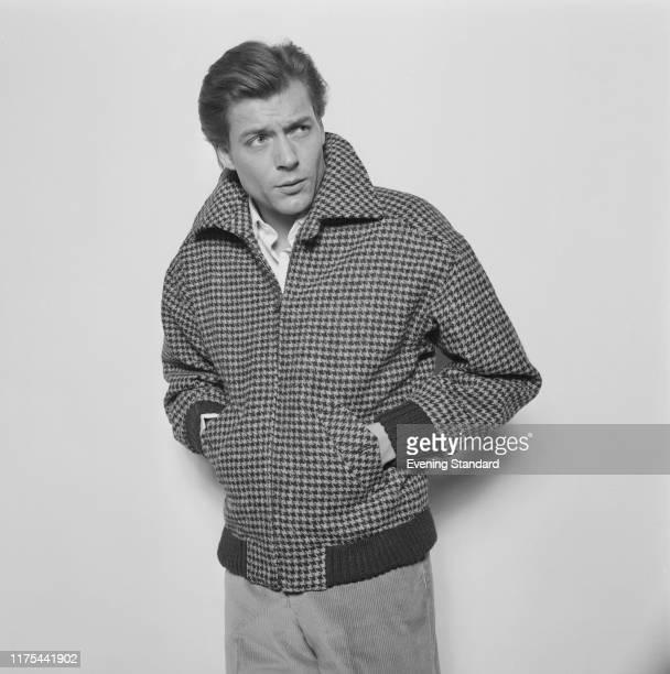 Male fashion model wearing wool tweed bomber jacket, UK, 20th December 1976.