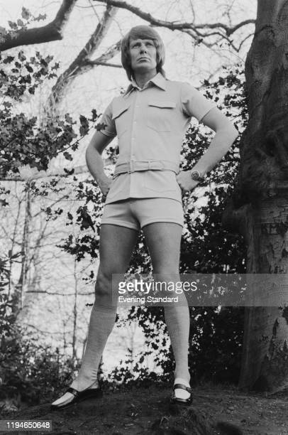Male fashion model wears a safari style belted short sleeved shirt with matching shorts, knee length socks and loafer shoes, 24th February 1971.