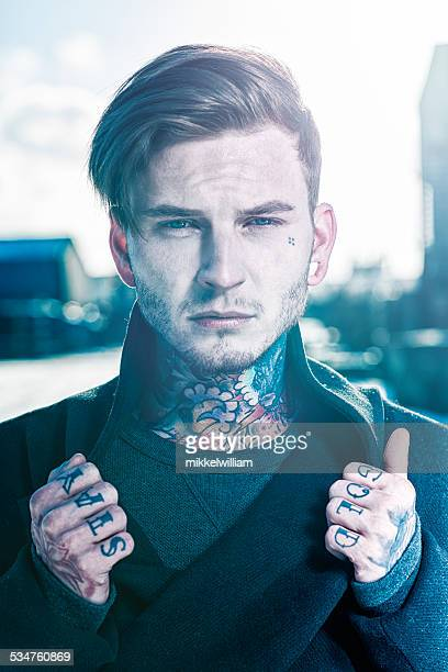 Male fashion model with lots of tattoos