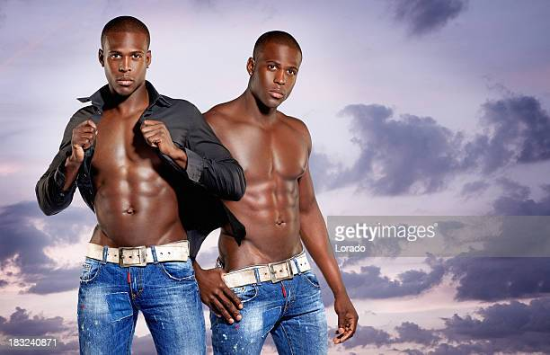 male fashion models posing against sky