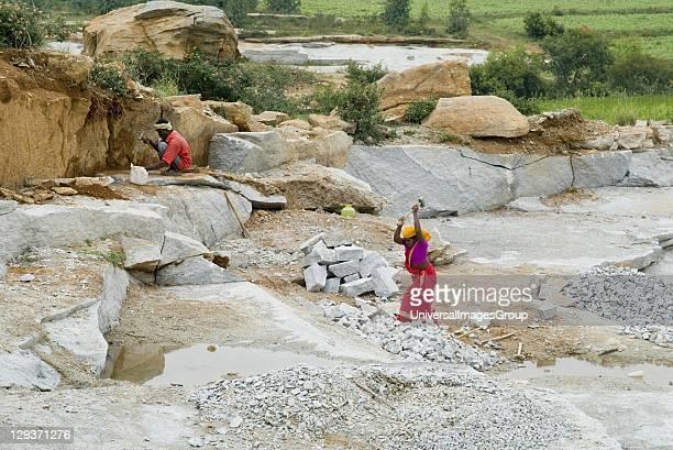 Male female labourers in granite quarry