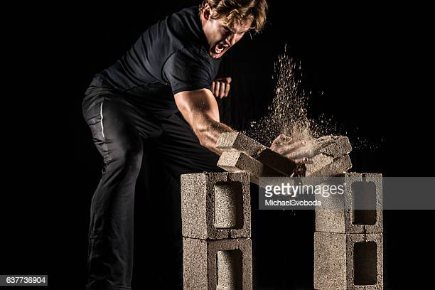 male fighter breaking bricks - punching stock pictures, royalty-free photos & images