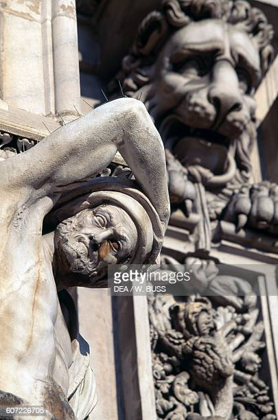 Male figure detail of the Milan Cathedral facade decoration Lombardy Italy