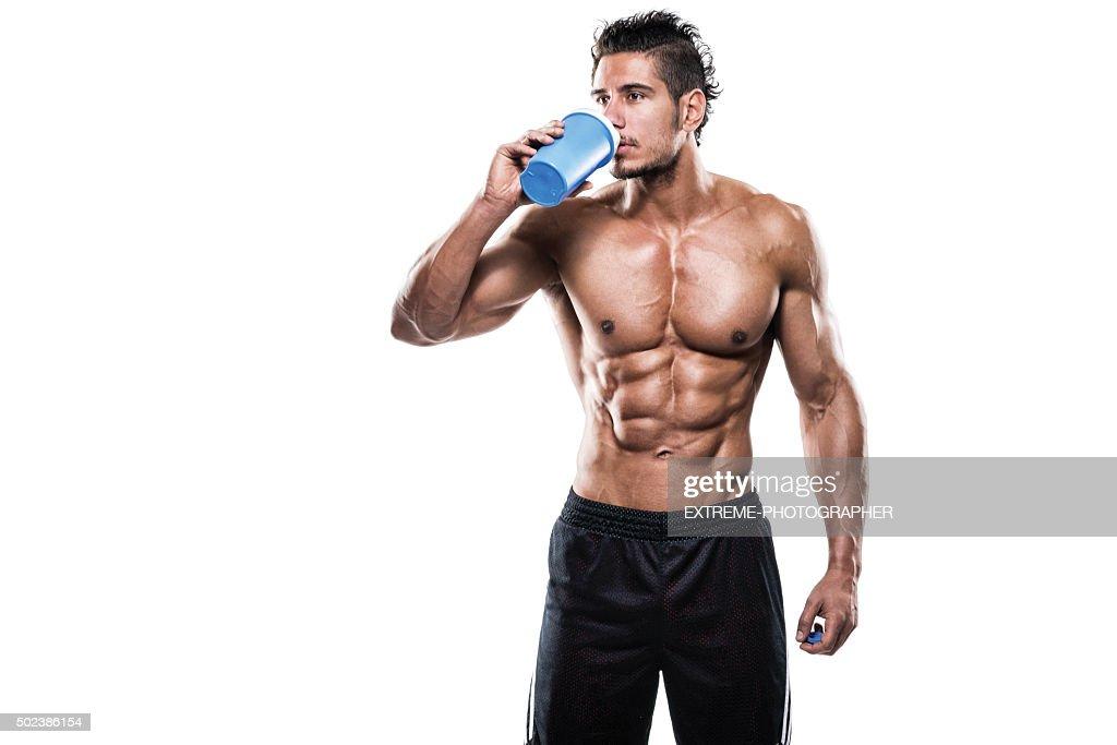 Male fitness athlete drinking protein shake : Stock Photo