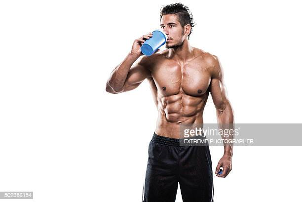 Male fitness athlete drinking protein shake