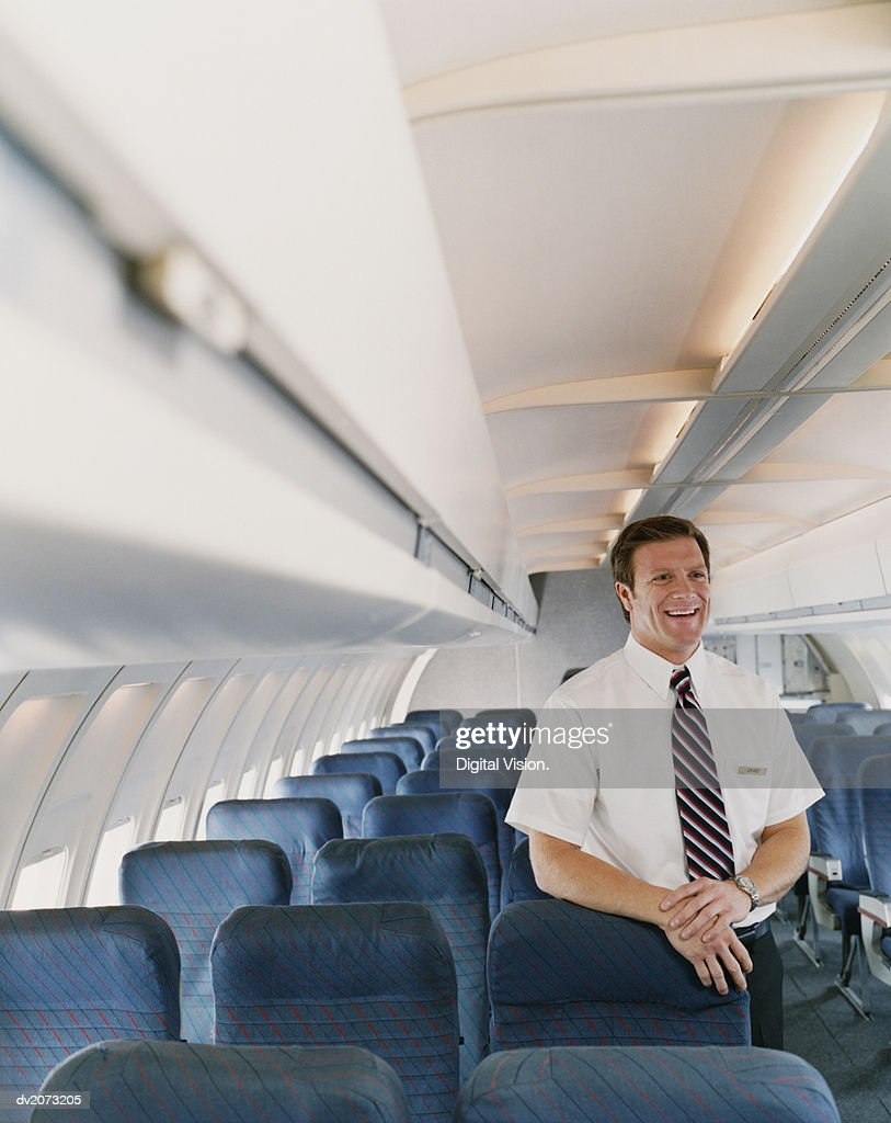 Male Flight Attendant on a Plane : Stock Photo