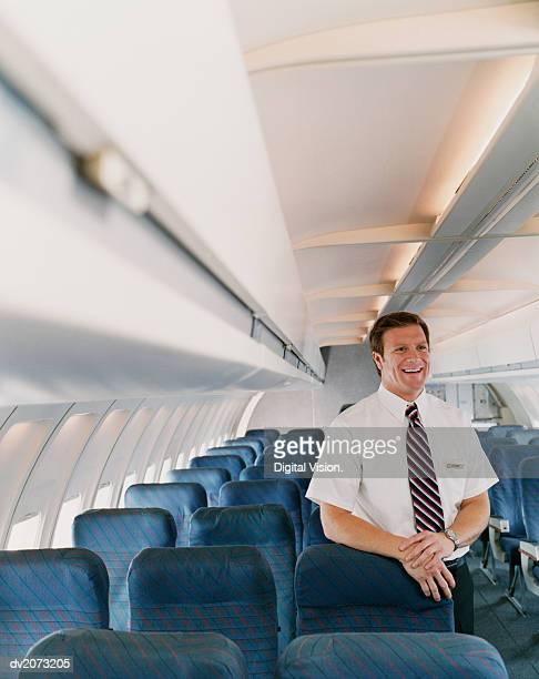 Male Flight Attendant on a Plane