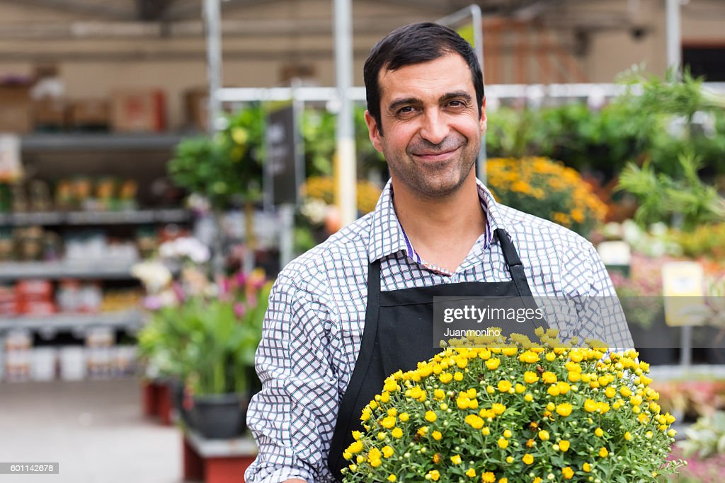 Male Florist working at a nursery : Stock Photo