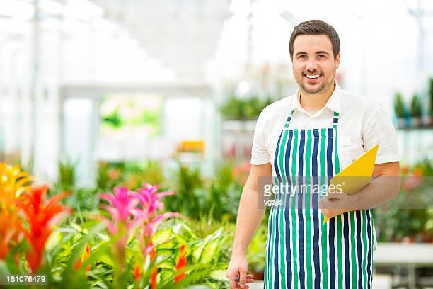 Male Florist Working At Garden Center.