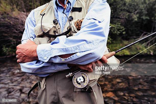 a male fly fisherman walks in a colorado stream near lake city, colorado - robb reece stock photos and pictures