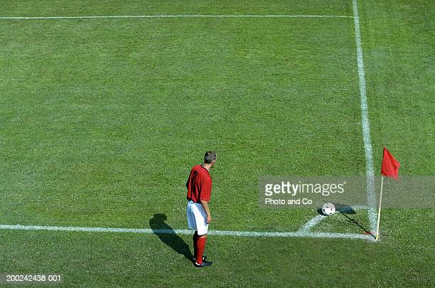 male football player preparing to take corner kick, elevated view - corner kick stock photos and pictures