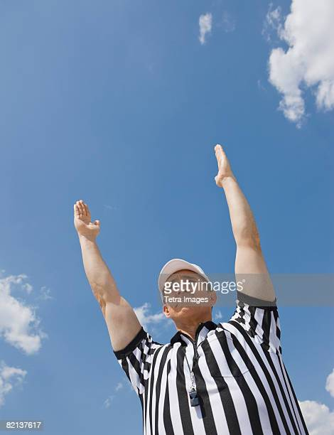 male football referee making touchdown call - american football judge stock pictures, royalty-free photos & images