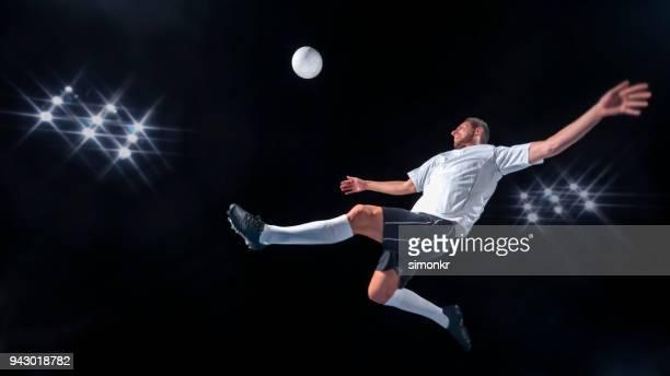 Male footballer kicking ball