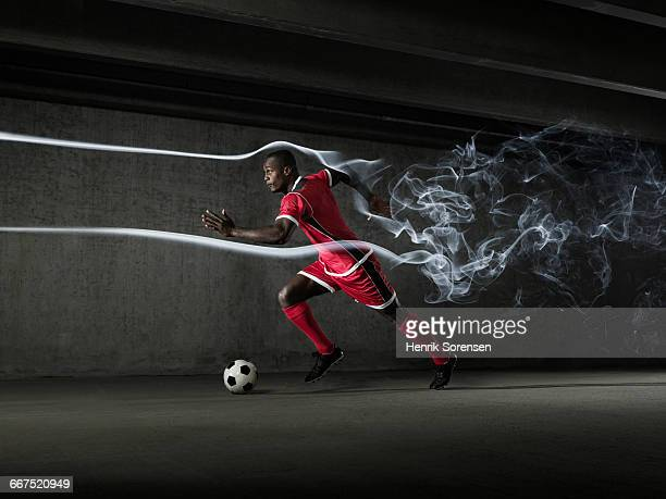 Male football/soccer player in windtunnel