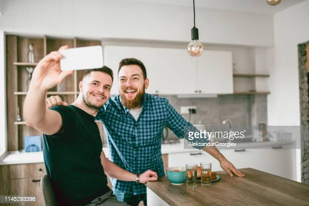 male friends enjoying morning together and taking selfie - mindzoom 2 stock pictures, royalty-free photos & images